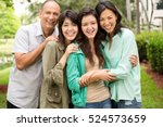 happy family with teenage... | Shutterstock . vector #524573659