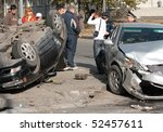 NOVOSIBIRSK - OCTOBER 11: Car accident on the road with participation of two cars. One has turned over October 11, 2009 in Novosibirsk, Russia - stock photo