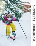 kid at a winter resort putting... | Shutterstock . vector #524583340