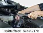 elderly woman repairing her car | Shutterstock . vector #524612170