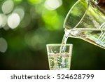 glass of water on nature...   Shutterstock . vector #524628799