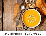 bowl of pumpkin soup on rustic...   Shutterstock . vector #524679610