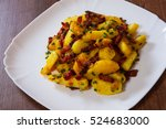Fried Potatoes With Bacon In A...