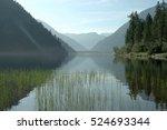 Stock photo magic sunrise on a mountain lake 524693344