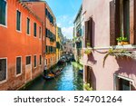Scenic Canal With Gondolas And...