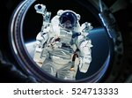 Earth Planet And Astronaut In...