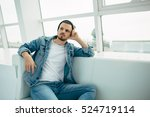 young man is sitting on sofa...   Shutterstock . vector #524719114