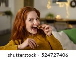 redhead woman sitting on her... | Shutterstock . vector #524727406