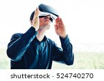 the man with glasses of virtual ... | Shutterstock . vector #524740270