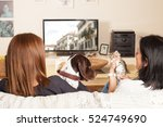 Stock photo family watching tv with pets 524749690