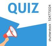 quiz announcement. hand holding ... | Shutterstock .eps vector #524773324