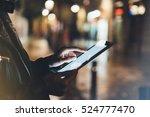 girl holding in hands on blank... | Shutterstock . vector #524777470