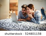 young married couple lying on... | Shutterstock . vector #524801158