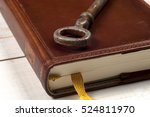 old keys on a old book on... | Shutterstock . vector #524811970