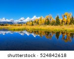 reflection of snow capped... | Shutterstock . vector #524842618