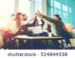 Small photo of Female and male classmates celebrating pathing math examination, feeling exciting and cheerful , giving high five during informal meeting in friendly atmosphere with modern laptop in coworking space