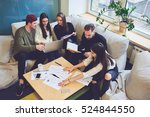 Small photo of Female and male classmates doing homework for business course, accounting data, making graphic illustrations during informal meeting in friendly atmosphere with modern laptop in coworking space
