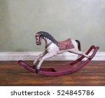 Vintage Rocking Horse On Woode...