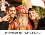 tourist selfie with a sadhu in... | Shutterstock . vector #524855140