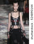 Small photo of PARIS, FRANCE - OCTOBER 3: A model walks the runway during the Alexander McQueen designed by Sarah Burton show as part of the PFW Womenswear SS2017 on October 3, 2016 in Paris, France