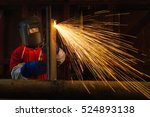 Worker Welding Construction By...