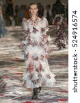 Small photo of PARIS, FRANCE - OCTOBER 3: A model walks the runway during the Alexander McQueen designed by Sarah Burton show as part of the Paris Fashion Week Spring/Summer 2017 on October 3, 2016 in Paris, France