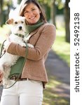 Stock photo woman walking dog outdoors in autumn park 52492138
