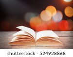 abstract magic book on wooden... | Shutterstock . vector #524928868