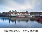 Small photo of Amsterdam central railway station and adjourned building reflects in the canal