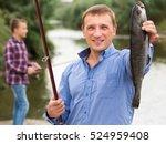Positive Fisherman Holding...
