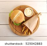 fried potatoes in a paper bag ... | Shutterstock . vector #525042883