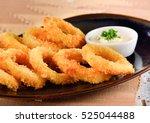 fried squid rings breaded  | Shutterstock . vector #525044488