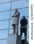 Small photo of outdoor elegant bronze statue of Sir Alex Ferguson, one of the most successful football manager in the world standing in Old Trafford football stadium in Manchester , England , United Kingdom