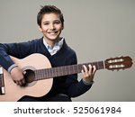 happy boy playing on acoustic... | Shutterstock . vector #525061984