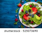 mixed salad leaves with berries ... | Shutterstock . vector #525073690