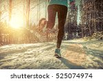 woman running at snowly winter... | Shutterstock . vector #525074974