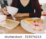 woman in cafe with donut and... | Shutterstock . vector #525076213