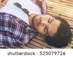 young man sleep on bamboo bed. | Shutterstock . vector #525079726