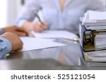 binders with papers are waiting ... | Shutterstock . vector #525121054
