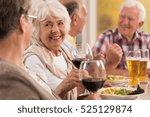 happy seniors talking and... | Shutterstock . vector #525129874