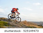 cyclist in red jacket riding... | Shutterstock . vector #525149473
