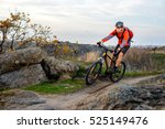 cyclist in red jacket riding... | Shutterstock . vector #525149476