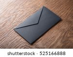 black envelope on  wooden table | Shutterstock . vector #525166888