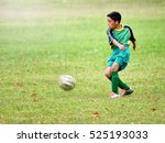 young boy playing soccer | Shutterstock . vector #525193033