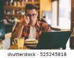 man is eating in a restaurant... | Shutterstock . vector #525245818