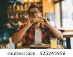 man is eating in a restaurant... | Shutterstock . vector #525245926
