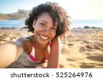 Small photo of Pretty girl taking a selfie at the beach
