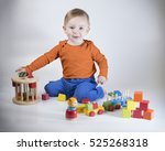 child playing with wooden toys | Shutterstock . vector #525268318