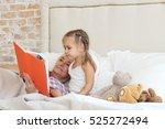 happy small girl lying in bed...   Shutterstock . vector #525272494