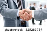 closeup of a business handshake | Shutterstock . vector #525283759